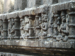 Yogini relief sculpture detail of main Kamakhya temple exterior.